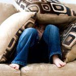 Fear - a little boy hiding